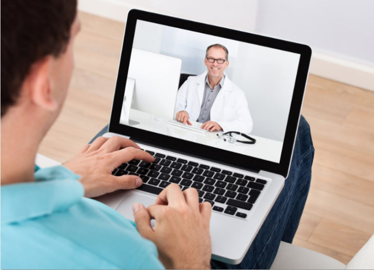 a man using Virtual care on his laptop